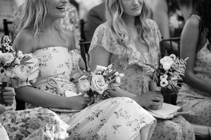 My beautiful bridesmaids wore romantic floral dresses with small bouquets of olive leaves, garden roses, lisianthus, and aster.