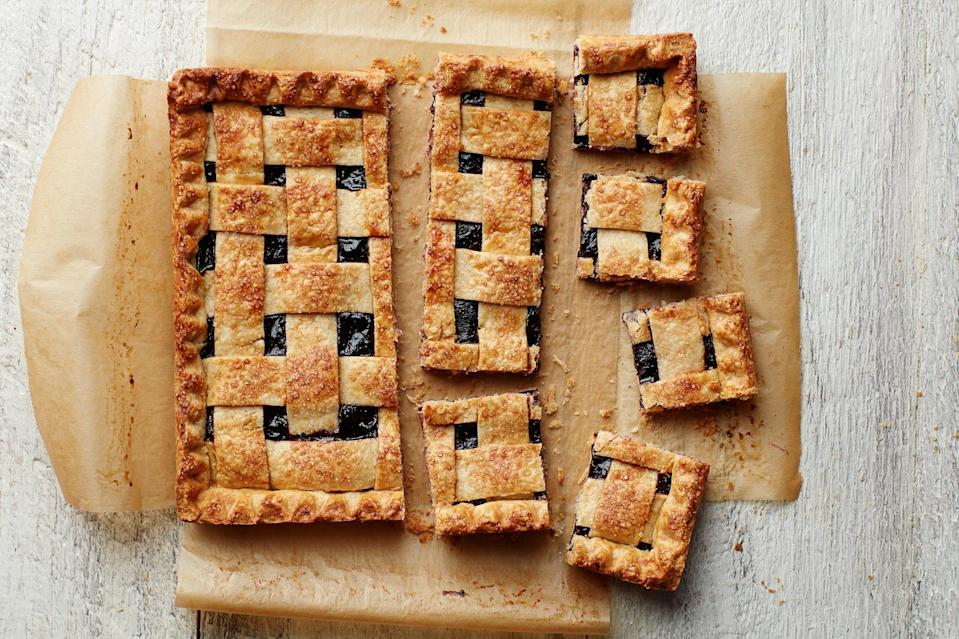 """A bright berry filling and a buttery flaky crust make this hand-held pie totally irresistible. Serve after a meal of turkey burgers or shrimp skewers on the grill, and everyone will be happy. <a href=""""https://www.epicurious.com/recipes/food/views/mixed-berry-pie-bars?mbid=synd_yahoo_rss"""" rel=""""nofollow noopener"""" target=""""_blank"""" data-ylk=""""slk:See recipe."""" class=""""link rapid-noclick-resp"""">See recipe.</a>"""