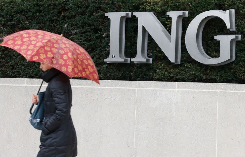A pedestrian walks past the logo of ING bank by the group's main office in Brussels