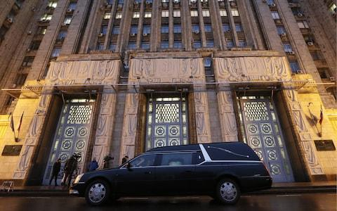 A hearse with the body of Russian Ambassador to Turkey Andrei Karlov outside the Russian Foreign Ministry in December - Credit: TASS / Barcroft Images