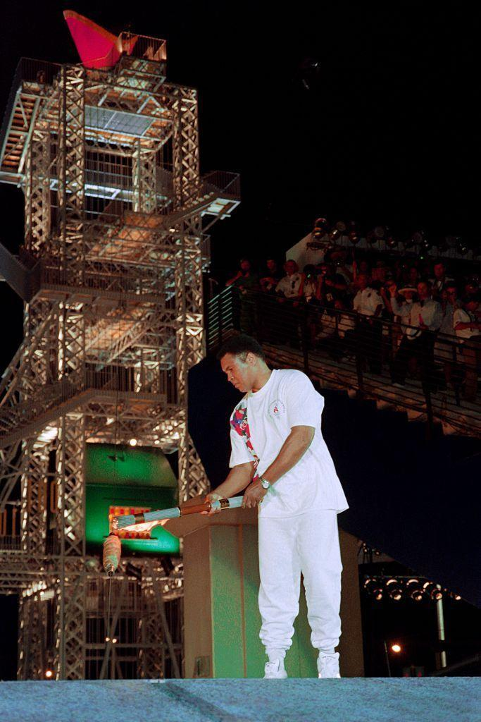 <p>In perhaps one of the most iconic Olympic moments of all time, Muhammad Ali lights the Olympic torch.</p>