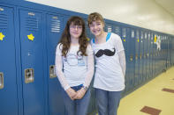 In this Thursday, June 6, 2013 photo, Margaret DeFer, left, and her twin sister, Eleanor, one of the twenty-four sets of twins from Highcrest Middle School in Wilmette, Ill. pose for a portrait at the school. The group is attempting to break a Guinness World record for the amount of twins in one grade which is currently sixteen sets. (AP Photo/Scott Eisen)