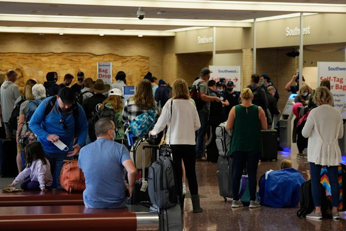 Passengers queue up at the ticketing counter for Southwest Airlines flights in Eppley Airfield in Omaha, Nebraska, on Oct. 10, 2021.