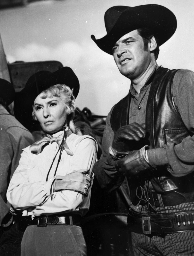 """In this 1965 file photo originally released by ABC, Peter Breck, right, is shown with Barbara Stanwyck in a scene from the TV series """"Big Valley."""" Breck died Monday Feb. 6, 2012, in Vancouver, British Columbia, after a long illness, his wife, Diane, announced on the website The Big Valley Writing Desk. He was 82. (AP Photo/ABC, file)"""