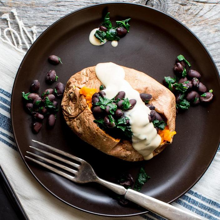 <p>Hearty yet simple to prepare, this stuffed sweet potato with black beans, kale and hummus dressing is a fantastic 5-ingredient lunch for one!</p>