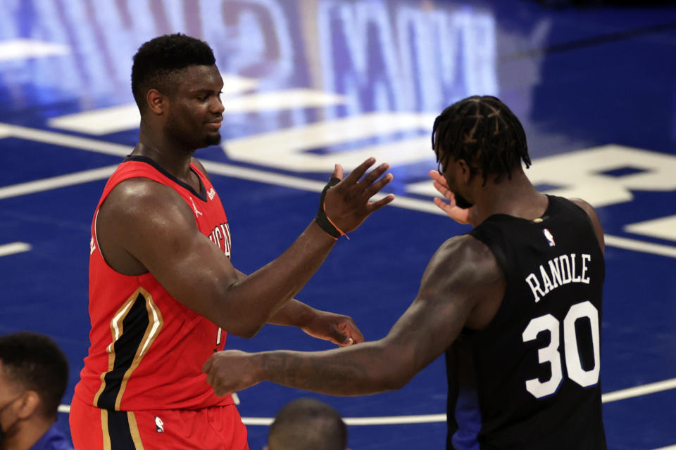 New Orleans Pelicans forward Zion Williamson, left, shakes hands with New York Knicks forward Julius Randle.