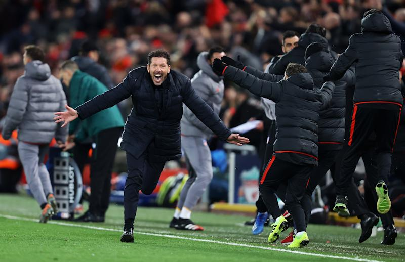 LIVERPOOL, ENGLAND - MARCH 11: Diego Simeone, Manager of Atletico Madrid celebrates his sides second goal during the UEFA Champions League round of 16 second leg match between Liverpool FC and Atletico Madrid at Anfield on March 11, 2020 in Liverpool, United Kingdom. (Photo by Julian Finney/Getty Images)