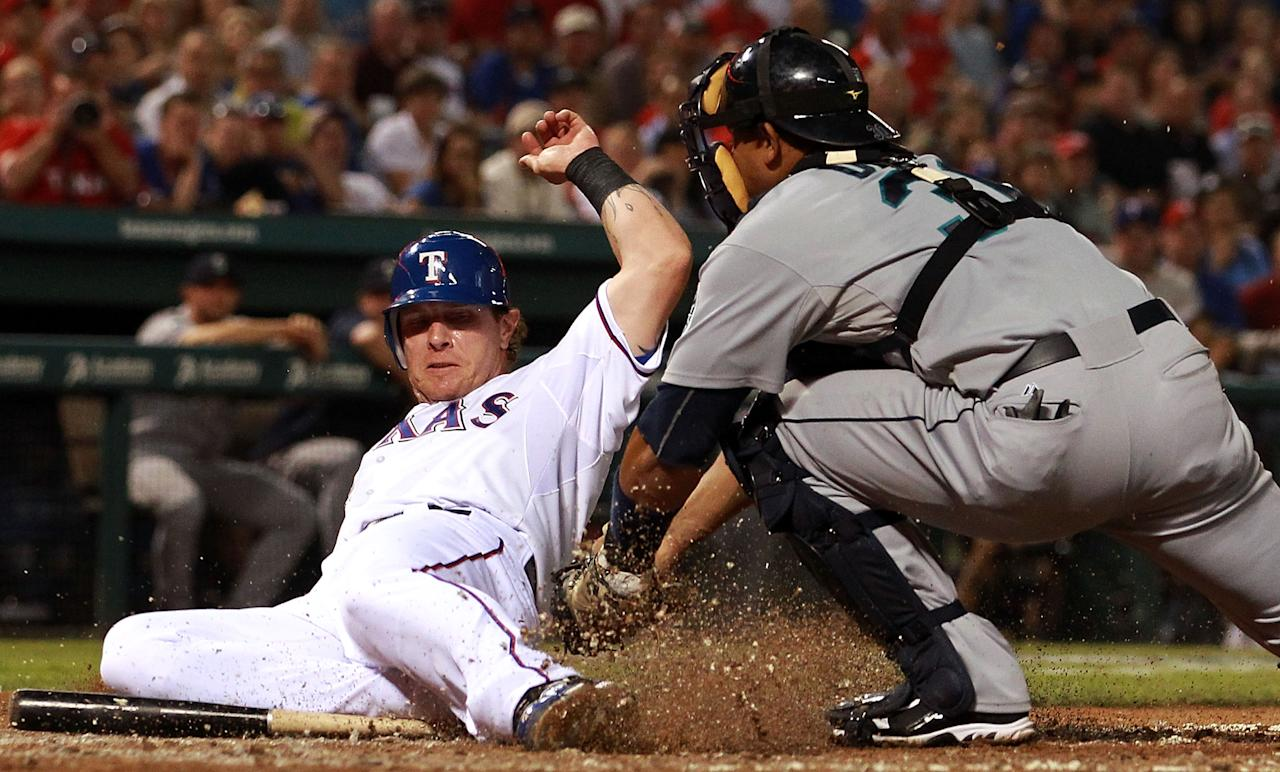 ARLINGTON, TX - APRIL 09:  Josh Hamilton #32 of the Texas Rangers is called out at home against Miguel Olivo #30 of the Seattle Mariners at Rangers Ballpark in Arlington on April 9, 2012 in Arlington, Texas.  (Photo by Ronald Martinez/Getty Images)