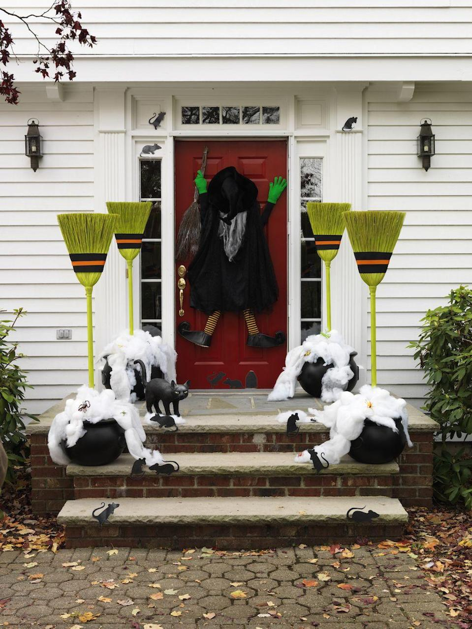"""<p>If you're partial to witch costumes, stay on theme by decorating your front door with one. Make even more of an impact by adding a few broomsticks to the arrangement. </p><p><a class=""""link rapid-noclick-resp"""" href=""""https://go.redirectingat.com?id=74968X1596630&url=https%3A%2F%2Fwww.wayfair.com%2Foutdoor%2Fpdp%2Fthe-holiday-aisle-crashing-witch-wilma-wipeout-figurine-w000086961.html&sref=https%3A%2F%2Fwww.goodhousekeeping.com%2Fholidays%2Fhalloween-ideas%2Fg32948621%2Fhalloween-door-decorations%2F"""" rel=""""nofollow noopener"""" target=""""_blank"""" data-ylk=""""slk:SHOP WITCH"""">SHOP WITCH</a></p>"""