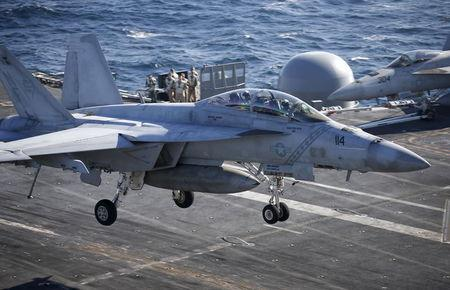 A U.S. Navy  F/A-18 Super Hornet fighter lands onto the deck of the USS Ronald Reagan, a Nimitz-class nuclear-powered super carrier, during a joint naval drill between South Korea and the U.S., in the West Sea