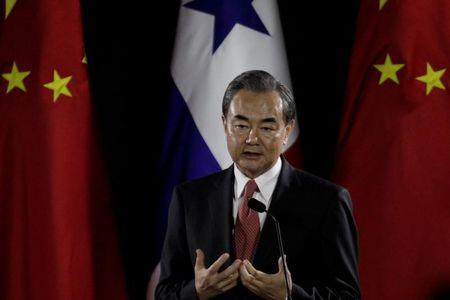 Chinese Foreign Minister Wang Yi addresses the audience during a news conference at Bolivar Palace in Panama City