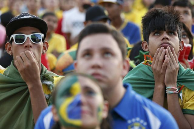 Fans of Brazil react while watching a broadcast of the 2014 World Cup semi-final against Germany at the Fan Fest in Brasilia, July 8, 2014. REUTERS/Ueslei Marcelino (BRAZIL - Tags: SOCCER SPORT WORLD CUP)