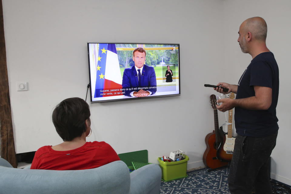 The family Ithurrioz watches French President Emmanuel Macron during his televised address, in Bayonne, southwestern France, Sunday, June 14, 2020. French President Emmanuel Macron is giving an address to his nation after an unusually long silence, as France faces both exceptional economic blowback from the virus pandemic and rekindled anger over deep-seated racism. (AP Photo/Bob Edme)