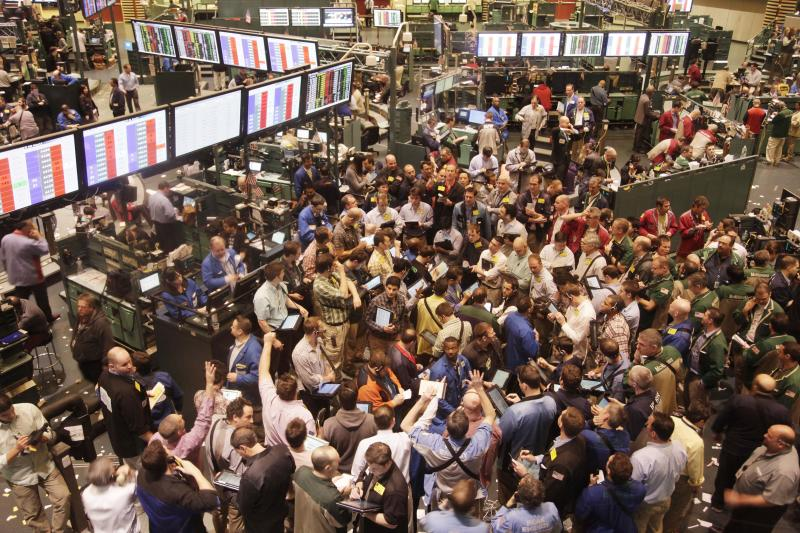 Traders exchange oil options, Thursday, March 24, 2011 at the New York Mercantile Exchange. Oil prices rose above $106 a barrel Thursday as a wave of violent protests and uprisings rocked the oil-rich Arab world and U.S. gasoline inventories fell sharply. (AP Photo/Mark Lennihan)