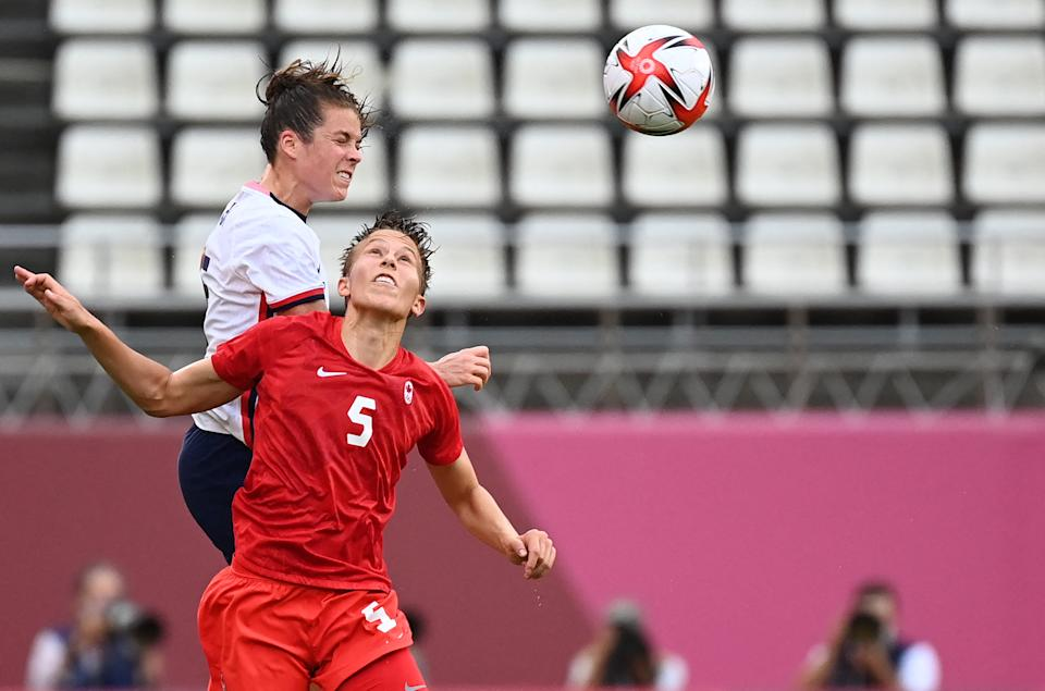 Canada's midfielder Quinn, right, blazed a trail for nonbinary visibility during the Tokyo 2020 Olympic Games. (Photo: MARTIN BERNETTI/AFP via Getty Images)