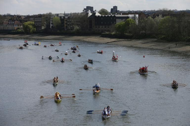 People row along the River Thames ahead of the annual Oxford-Cambridge Boat Race in London, on April 2, 2017