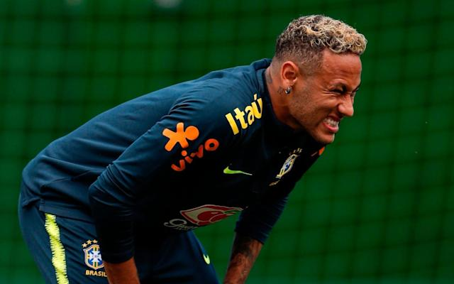 """Brazil have been given a scare ahead of Friday's clash with Costa Rica after Neymar missed training for a second successive day. The news came as Philippe Coutinho warned his Brazil team-mates that there would be no margin for error against the Costa Ricans in St Petersburg following their disappointing 1-1 draw in their opening game against Switzerland on Sunday. Neymar, who had sat out training on Monday, was unable to take part in Tuesday's session after complaining of pain to his right ankle. The Paris St-Germain forward, who had managed only a few warm up exercises, was seen kicking a ball away in frustration as he hobbled off in the company of Brazil physiotherapist, Bruno Manek, at the team's base in Sochi. Rodrigo Lasmar, Brazil's doctor, said Neymar would receive more treatment on Wednesday morning but was due to return to full training in afternoon, with Brazil confident the player will be fit to play on Friday. Coutinho said Neymar's fitness was not a worry and the pain he was feeling was """"normal"""". URGENTE! Em Sochi, Neymar sente e deixa o treino da Seleção mancando nesta terça-feira (19). Confira o momento! #Copa2018pic.twitter.com/ZNRboOu4Hf— Esporte Interativo (@Esp_Interativo) 19 June 2018 But the situation is still a concern for Brazil, not least as their coach, Tite, had warned before the Switzerland game that Neymar was """"not 100 per cent fit"""" after fracturing the fifth metatarsal in his right foot in February and would require careful handling in Russia. The Swiss result has also increased the pressure to deliver against Costa Rica. """"We will treat the game like it's the final game,"""" said Coutinho, the Barcelona and former Liverpool forward whose stunning strike had put Brazil in front against Switzerland. """"We are aware we have no more room for error."""" Brazil blamed Neymar's problem on his treatment by Switzerland when he was fouled 10 times, more than any player at a World Cup since Alan Shearer at France '98. However, it was after Neymar slammed h"""