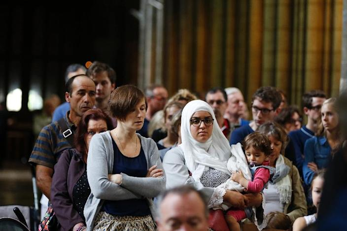 Muslims across France were invited to participate in Catholic ceremonies on July 31, 2016 following the murder of a priest by jihadists (AFP Photo/Charly Triballeau)