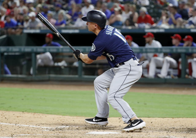Seattle Mariners' Kyle Seager follows through on a two-run triple off Texas Rangers starting pitcher Taylor Guerrieri during the seventh inning of a baseball game in Arlington, Texas, Tuesday, July 30, 2019. (AP Photo/Tony Gutierrez)