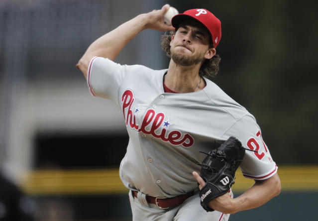 Philadelphia Phillies starting pitcher Aaron Nola throws against the Colorado Rockies in the first inning of a baseball game in Denver, Saturday, April 20, 2019. (AP Photo/Joe Mahoney)