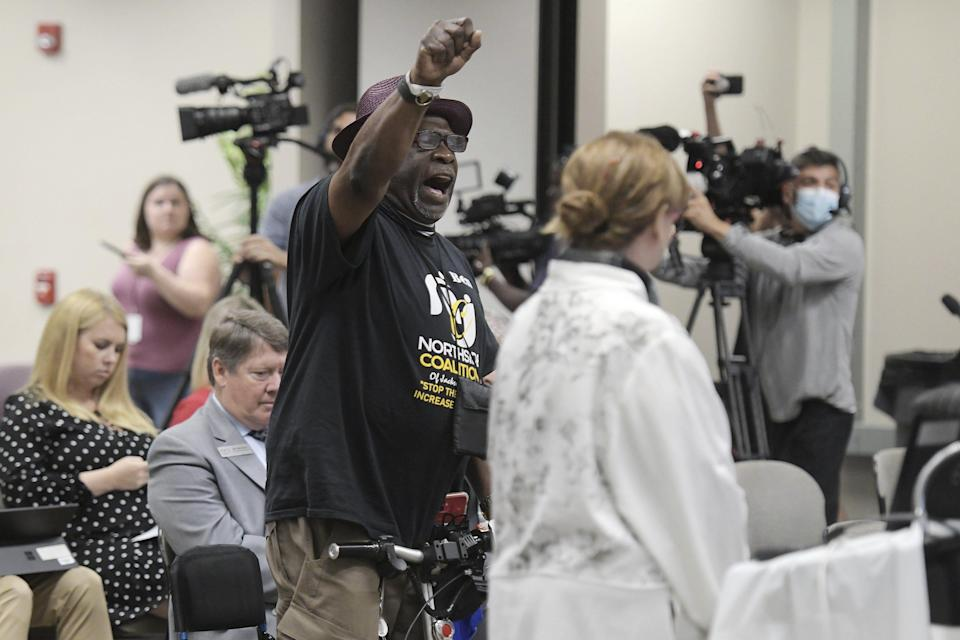 """Ben Frazier, the founder of the Northside Coalition of Jacksonville chants """"Allow teachers to teach the truth"""" at the end of his public comments opposing the state of Florida's plans to ban the teaching of critical race theory in public schools during the Department of Education meeting Thursday."""