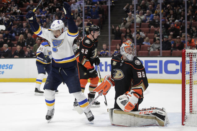 St. Louis Blues' Brayden Schenn, left, celebrates a goal by Ryan O'Reilly as Anaheim Ducks goaltender John Gibson looks back at the net during the first period of an NHL hockey game Wednesday, March 6, 2019, in Anaheim, Calif. (AP Photo/Jae C. Hong)
