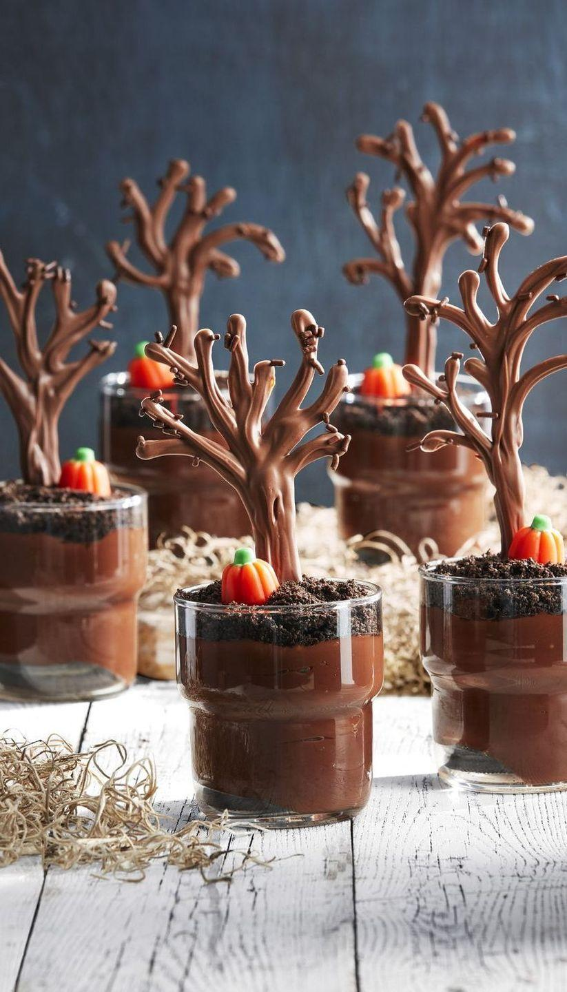 """<p>A classic chocolate pudding cup is a great go-to dessert, and these spooky forrest cups will definitely set the Halloween mood. </p><p><strong><em>Get the recipe at <a href=""""https://www.countryliving.com/food-drinks/a28943384/spooky-forest-pudding-cups/"""" rel=""""nofollow noopener"""" target=""""_blank"""" data-ylk=""""slk:Country Living"""" class=""""link rapid-noclick-resp"""">Country Living</a>.</em></strong> </p>"""