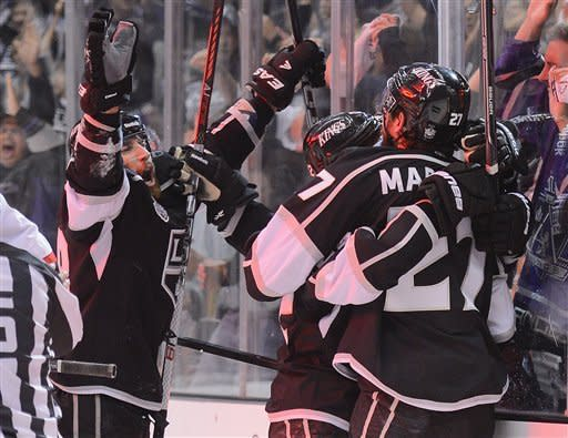 The Los Angeles Kings celebrate a second period goal by Alec Martinez against the New Jersey Devils during Game 3 of the Stanley Cup Finals, Monday, June 4, 2012, in Los Angeles. (AP Photo/Mark J. Terrill)