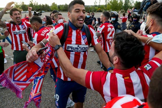 Luis Suarez celebrates with Atletico Madrid fans on Saturday after his winning goal at Real Valladolid clinched the LaLiga title on the final day of the season