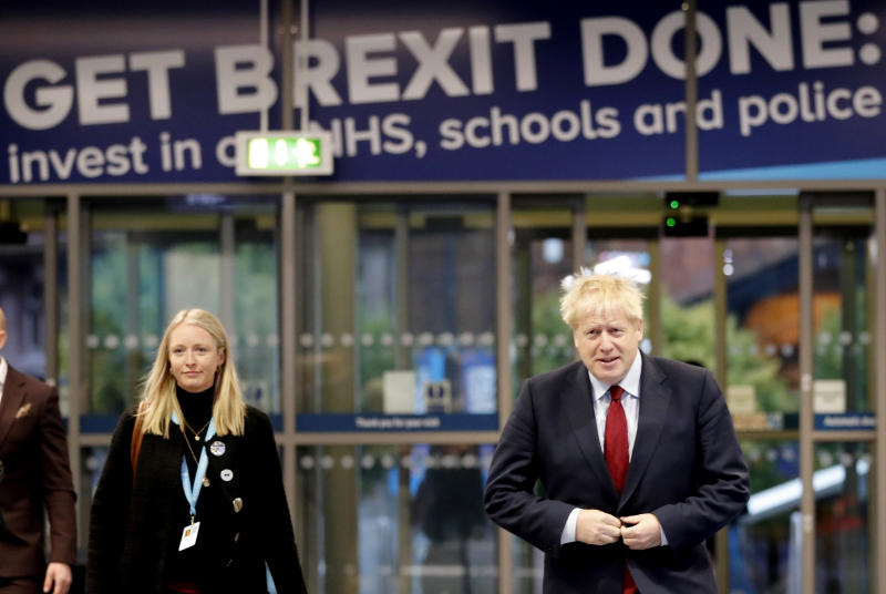 Britain's Prime Minister Boris Johnson arrives for interviews at the Conservative Party Conference in Manchester, England, Tuesday, Oct. 1, 2019.(AP Photo/Frank Augstein)