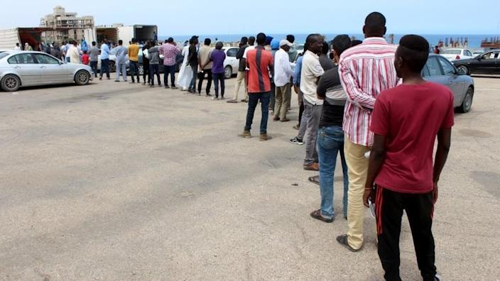 Migrants queue for food aid. Libya is a major transit point for attempts to reach Europe. File image