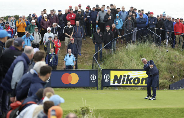 Northern Ireland's Darren Clarke plays his tee shot on the 9th hole during the first round of the British Open Golf Championships at Royal Portrush in Northern Ireland, Thursday, July 18, 2019.(AP Photo/Peter Morrison)