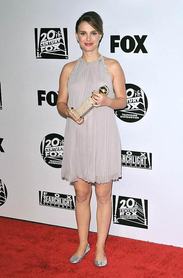 "Natalie Portman also traded in her formal Globes gown for a cute halter frock by Azzaro at Fox Searchlight's post shindig. The pregnant celeb's best accessories? Her silver ballet flats -- and her Golden Globe award, of course! Craig Barritt/<a href=""http://www.wireimage.com"" target=""new"">WireImage.com</a> - January 16, 2011"