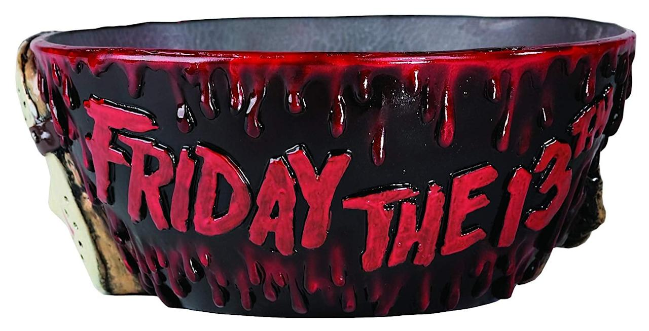 "<p>Serve up <s>revenge</s> chips, candy, or punch in this <a href=""https://www.popsugar.com/buy/strongFriday-13thstrong-Jason-Punch-Bowl-479914?p_name=%3Cstrong%3EFriday%20the%2013th%3C%2Fstrong%3E%20Jason%20Punch%20Bowl&retailer=amazon.com&pid=479914&evar1=yum%3Auk&evar9=46498977&evar98=https%3A%2F%2Fwww.popsugar.com%2Ffood%2Fphoto-gallery%2F46498977%2Fimage%2F46498984%2FFriday-13th-Jason-Punch-Bowl&list1=halloween%2Calcohol&prop13=api&pdata=1"" rel=""nofollow"" data-shoppable-link=""1"" target=""_blank"" class=""ga-track"" data-ga-category=""Related"" data-ga-label=""https://www.amazon.com/Rubies-Friday-13th-Jason-Punch/dp/B000H3XKQ6/ref=sr_1_45?keywords=halloween+punch+bowls&amp;qid=1565794863&amp;s=gateway&amp;sr=8-45"" data-ga-action=""In-Line Links""><strong>Friday the 13th</strong> Jason Punch Bowl</a> ($30).</p>"