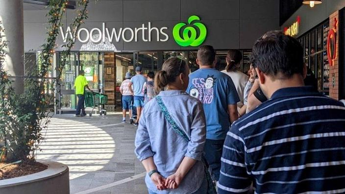 Shoppers line up in Brisbane on Monday