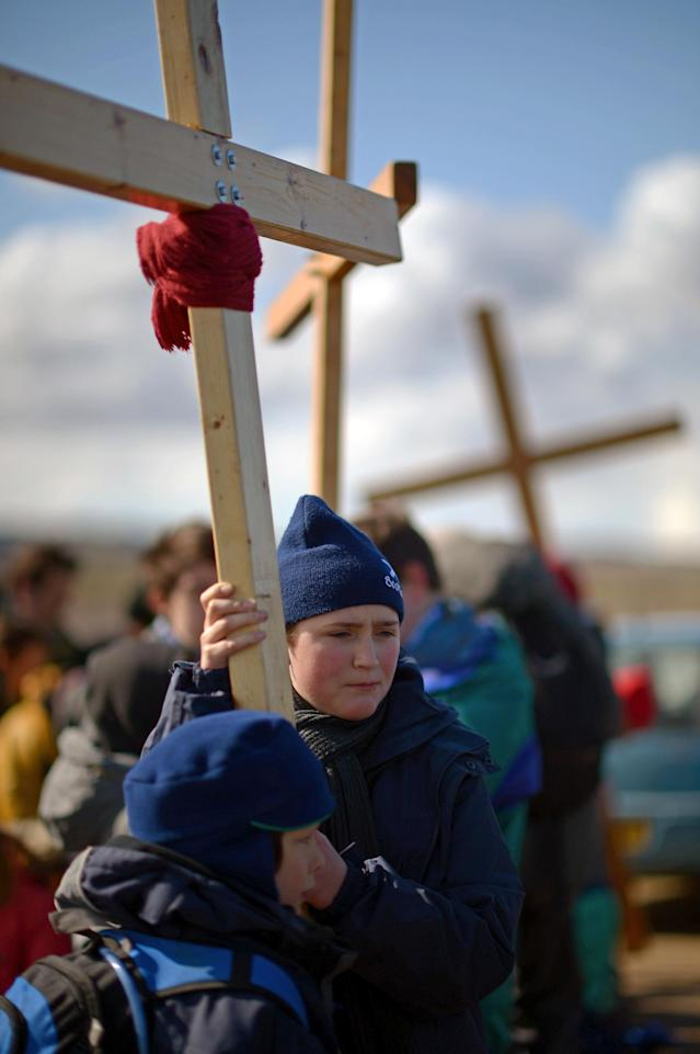 BERWICK-UPON-TWEED, ENGLAND - MARCH 29: Pilgrims walk with crosses as the Northern Cross pilgrimage undertakes its final leg of the journey to Holy Island on April 29, 2013 in Berwick-upon-Tweed, England. More than 50 people, young and old, celebrated Easter by crossing the tidal causeway during the annual Christian pilgrimage. Every year people of all ages, from all over the world and from all realms of Christian life walk together at Easter to Holy Island. (Photo by Jeff J Mitchell/Getty Images)