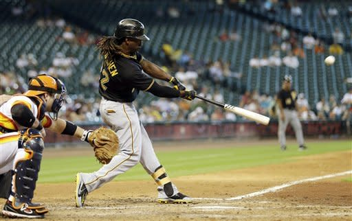 Pittsburgh Pirates' Andrew McCutchen (22) hits an RBI-double to score Josh Harrison as Houston Astros catcher Chris Snyder, left, reaches for the pitch during the sixth inning of a baseball game, Sunday, Sept. 23, 2012, in Houston. (AP Photo/David J. Phillip)