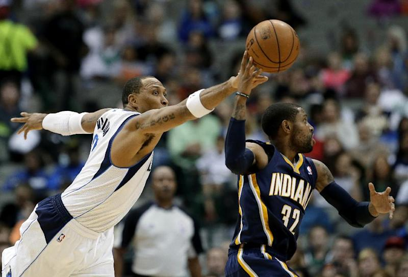 Dallas Mavericks forward Shawn Marion, left, attempts to steal the ball away from Indiana Pacers' C.J. Watson (32) in the first half of a preseason NBA basketball game, Friday, Oct. 25, 2013, in Dallas. (AP Photo/Tony Gutierrez)