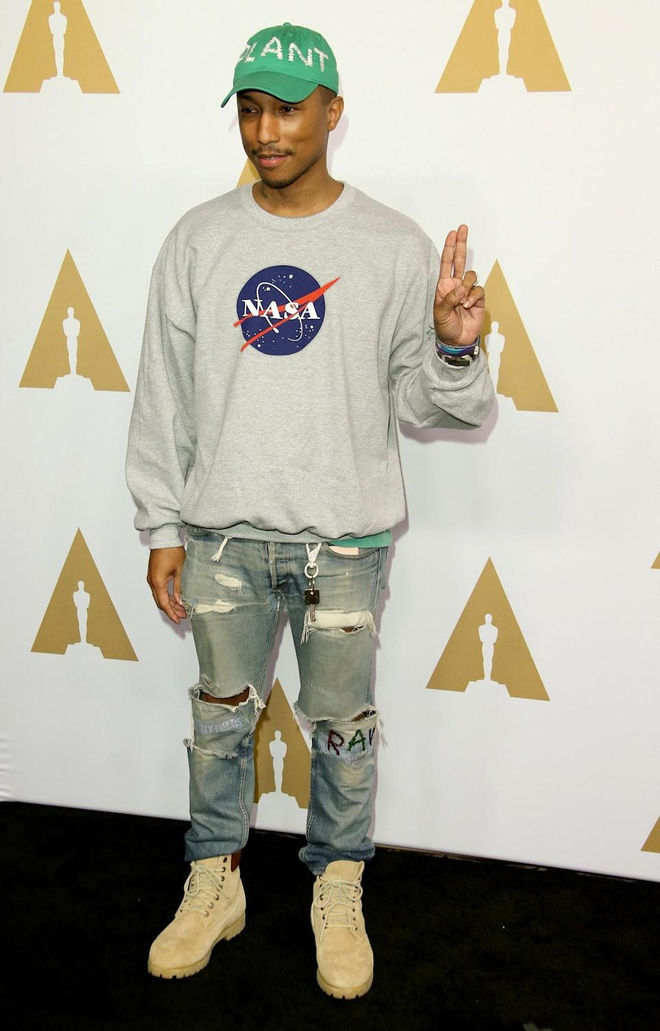 <p>Pharrell rocked up wearing jeans, a Nasa jumper and a cap which had 'plant' embroidered on it. Casual. [Photo: Getty] </p>