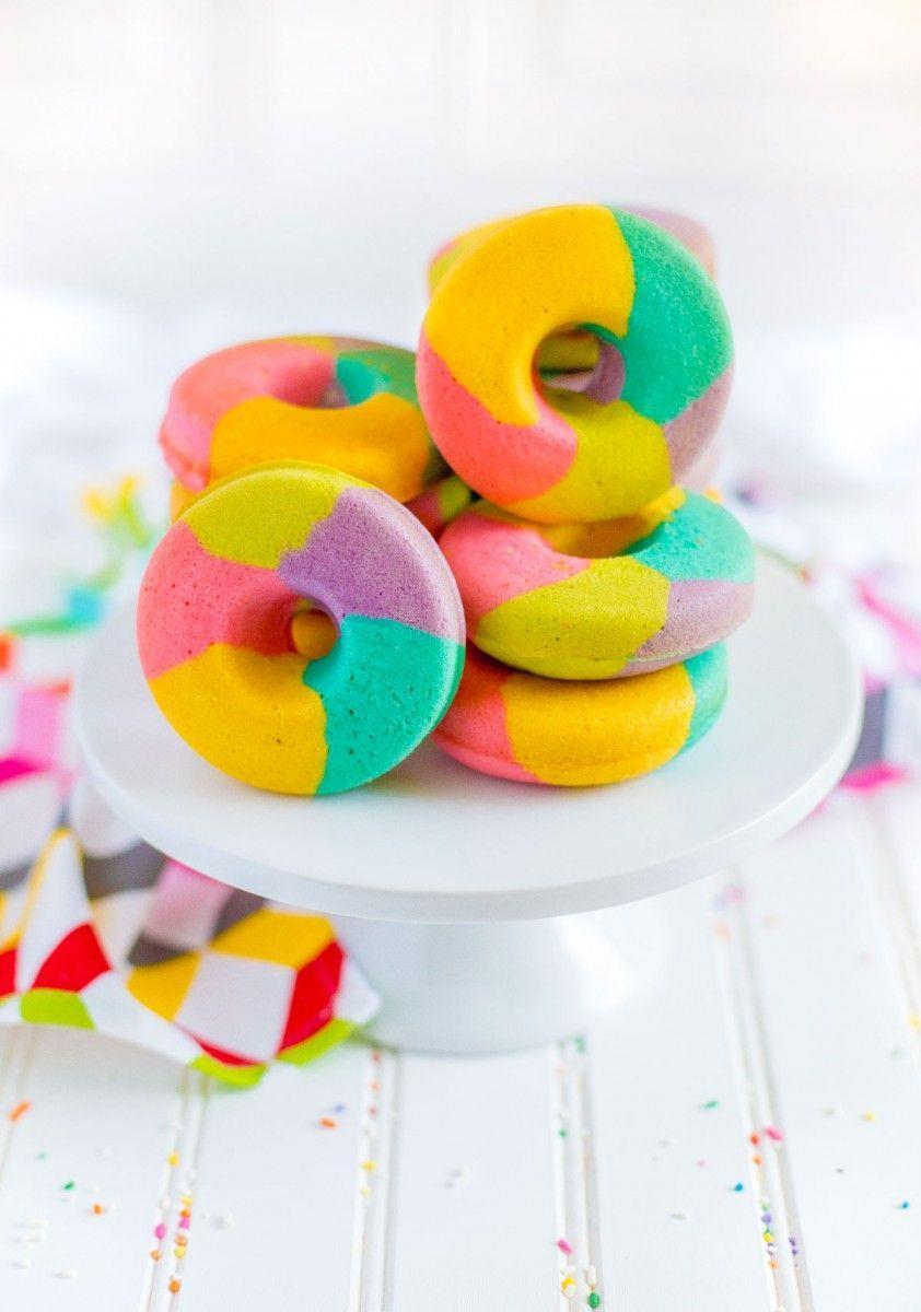 """<p>Serve these cute rainbow donuts at your next brunch to wow your friends. They're baked in the oven so you don't have to worry about the mess of frying.</p><p><strong>Get the recipe at <a href=""""https://www.confettiandbliss.com/rainbow-donut-recipe/"""" rel=""""nofollow noopener"""" target=""""_blank"""" data-ylk=""""slk:Confetti & Bliss"""" class=""""link rapid-noclick-resp"""">Confetti & Bliss</a>.</strong></p><p><strong><a class=""""link rapid-noclick-resp"""" href=""""https://go.redirectingat.com?id=74968X1596630&url=https%3A%2F%2Fwww.walmart.com%2Fsearch%2F%3Fquery%3Ddonut%2Bpan&sref=https%3A%2F%2Fwww.thepioneerwoman.com%2Ffood-cooking%2Fmeals-menus%2Fg36421919%2Frainbow-recipes%2F"""" rel=""""nofollow noopener"""" target=""""_blank"""" data-ylk=""""slk:SHOP DONUT PANS"""">SHOP DONUT PANS</a><br></strong></p>"""