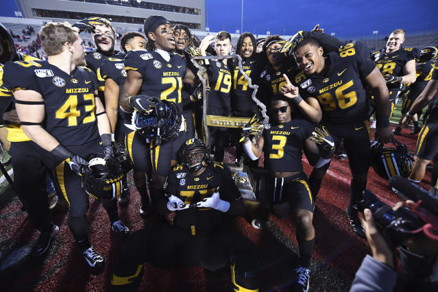 Missouri players celebrate with the Battle Line trophy after defeating Arkansas 24-14 during an NCAA college football game Friday, Nov. 29, 2019, in Little Rock, Ark. (AP Photo/Michael Woods)