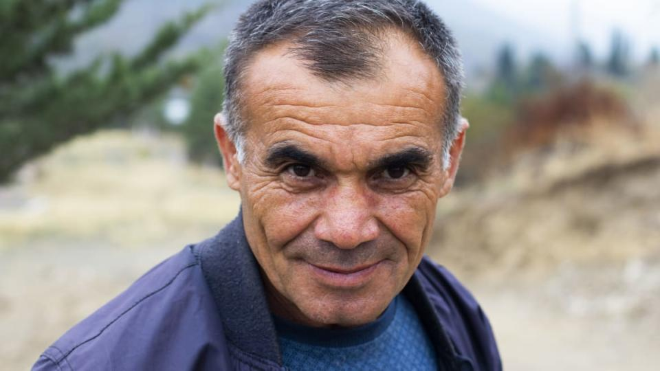 """<div class=""""inline-image__caption""""><p>Gravedigger Martin Ghulyan is a war veteran from the war almost 30 years ago. He was flown into Stepanakert back then in a helicopter and had to sneak past Russian soldiers to fight against the Azerbaijani soldiers. Today, he is ready to fight yet again.</p></div> <div class=""""inline-image__credit"""">Emil Filtenborg</div>"""