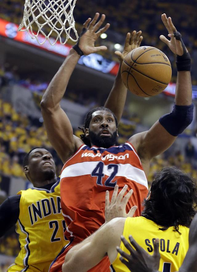 Indiana Pacers center Ian Mahinmi, left, blocks the shot of Washington Wizards forward Nene Hilario during the second quarter of game 1 of the Eastern Conference semifinal NBA basketball playoff series in Indianapolis, Monday, May 5, 2014(AP Photo/Michael Conroy)