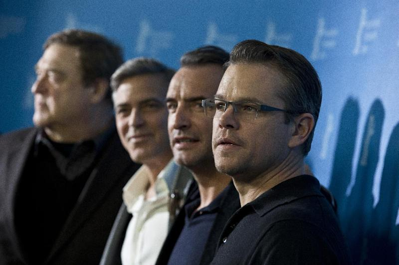 From right, actors Matt Damon, Jean Dujardin, George Clooney and John Goodman pose for photographers at the photo call for the film The Monuments Men during the 64th Berlinale International Film Festival on Saturday Feb. 8, 2014, in Berlin. (AP Photo/Axel Schmidt)