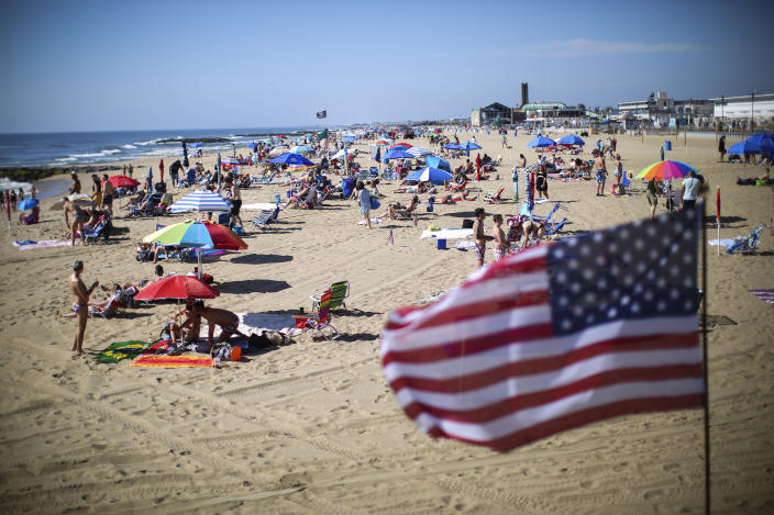 ASBURY PARK, NJ - MAY 26:  People visit the beach during Memorial Day weekend on May 26, 2019 in Asbury Park, New Jersey. Memorial Day is the unofficial start of summer and this year New Jersey has banned smoking and vaping on nearly every public beach under tougher new restrictions. (Photo by Kena Betancur/Getty Images)