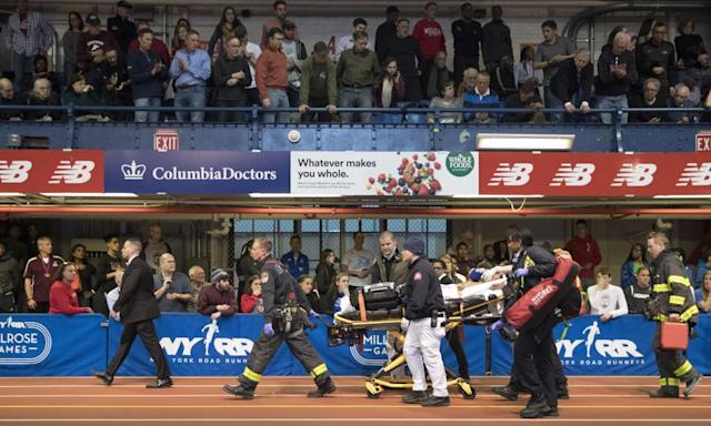 "<span class=""element-image__caption"">Emergency service personnel remove Kemoy Campbell from the track after he collapsed during his duty as a pace-setter in the men's 3000m race at the Millrose Games on Saturday.</span> <span class=""element-image__credit"">Photograph: Mary Altaffer/AP</span>"
