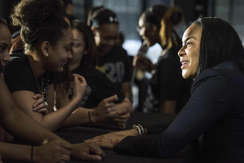 South Carolina women's head basketball coach Dawn Staley, right, talks with her South Carolina players during a press conference at Williams Brice Stadium, Friday, March 10, 2017, in Columbia, S.C. Staley has been named the women's national team head coach for the 2020 Olympic games in Tokyo. (AP Photo/Sean Rayford)