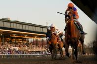 John Velazquez, right, rides Authentic to win the Breeder's Cup Classic horse race at Keeneland Race Course, in Lexington, Ky., Saturday, Nov. 7, 2020. (AP Photo/Darron Cummings)