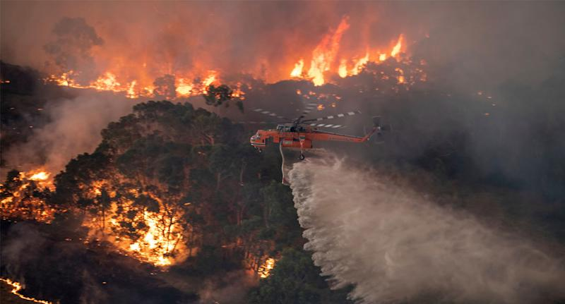 A helicopter fighting East Gippsland fires on December 30. Source: AAP