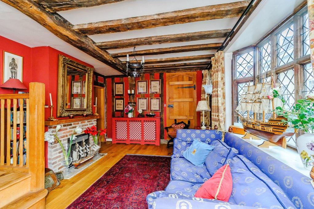 <p>Internal Medieval and Tudor features include a massive timber frame, fireplaces, wall paintings and a rare stone spiral staircase with carved brick hardrail. (Carter Jonas) </p>